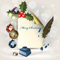 Sheet of paper, Christmas globes, ink pot and a fe Royalty Free Stock Image