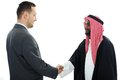 Sheikh making a deal with caucasian Royalty Free Stock Images
