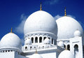 Sheikh zayed grand mosque against a blue sky the main domes of the highlighted Royalty Free Stock Photos
