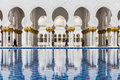 Sheikh Zayed Mosque Left Wing Corridor with Pool, The Great Marble Grand Mosque at Abu Dhabi, UAE Royalty Free Stock Photo