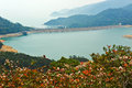 Shek pik reservoir and red leaves the photo was taken in lantau south country park hongkong china Royalty Free Stock Image