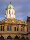 The sheldonian theatre in oxford dome and upper storeys of evening sunlight england uk Stock Image