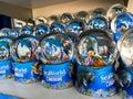 A shelf of Manatee, Dolphin and sea turtle souvenir snowglobes