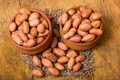 Shelled peanuts in a wooden pot o a old table Royalty Free Stock Photo