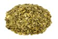 Shelled pumpkin seed isolated over white background Royalty Free Stock Images