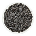 Shelled sunflower seeds in a glass bowl Royalty Free Stock Photo