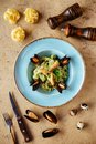 Shellfish Mussels in copper bowl with lemon and herbs. Shellfish seafood. Royalty Free Stock Photo
