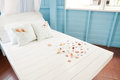 Shellfish with white pillow on the bed Stock Photography