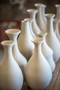 Shelve with ceramic dishware in pottery workshop Royalty Free Stock Photos