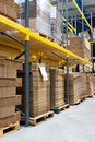 Shelves with cartons in warehouse Royalty Free Stock Photo