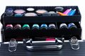 Shelves in makeup case close up big with different color containers jars tubes Stock Photos