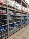 Shelves ottles are filled with bottles of soda and clean water grocery store in ukraine Royalty Free Stock Photo