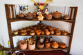Simple clay pots on blue shelves