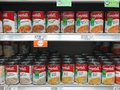 Shelves stocked with different varieties of Campbells Soup Royalty Free Stock Photo