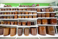 Shelves with variety of clay flowerpot Stock Photography