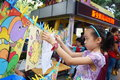 Shenzhen, China: children painting sale to help the people in trouble