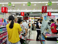 Shenzhen, China: supermarket cashier, customers pay in shopping Royalty Free Stock Photo