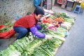 Shenzhen china woman selling vegetables in december st baoan xixiang the alley a Royalty Free Stock Photography