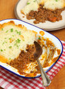 Shepherds pie in serving dish homemade enamel Stock Photos