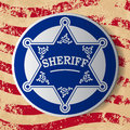 Sheriff star stars with decorations on grunge flag background Royalty Free Stock Images