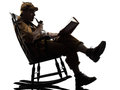 Sherlock holmes reading silhouette sitting in rocking chair in studio on white background Stock Photography