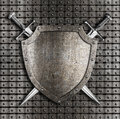 Shield and swords hanging on metal wall two crossed with rivets Stock Photos