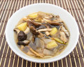 Shiitake mushroom soup with onion and potato on bamboo mat Royalty Free Stock Photography