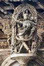 Shilabalika, celestial maiden, as a Kapikupite. Monkey, in the bottom left corner, pulling Saree. Chennakeshava temple, Belur, Kar Royalty Free Stock Photo