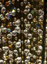 Shimmering Glass Crystal Spheres Hanging Vertically. Royalty Free Stock Photo