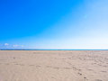 Shining blue sky sea and sand beach Stock Photos