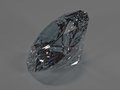 Shining diamond on a gray background, side view Royalty Free Stock Photo