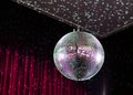 Shining disco ball on red background Royalty Free Stock Photo