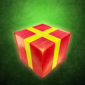 Shining gift box on a green grunge backgrounds background Royalty Free Stock Images