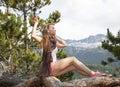 Shining girl the in earrings posing in yucatania point skagway alaska Royalty Free Stock Images