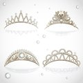 Shining gold tiaras with diamonds and pearls on white background Stock Images
