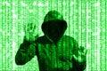 Shining green hacker behind computer code matrix Royalty Free Stock Photo