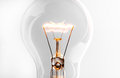 Shining Light Bulb Close Up On Bright Background Royalty Free Stock Photo