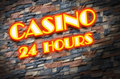 Shining neon sign of casino with bricks background Royalty Free Stock Photos