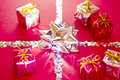 Shining red and silver Christmas presents Royalty Free Stock Photos