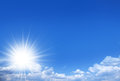 Shining sun on the blue sky nature background Royalty Free Stock Photos
