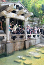 Shinto believers rinse their mouths and clean their hands kyoto japan april japanese people before worshiping at shrine in Royalty Free Stock Photography