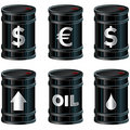 Shiny Black Oil Barrels With Symbols Royalty Free Stock Photography