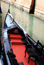 Shiny black and red gondola in Venetian canal Stock Image