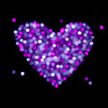Shiny blurred heart valentine card violet and pink colored lights in the form of on the black background valentines day or wedding Stock Photo