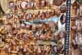 Shiny brass utensils are suspended in crockery store, Yazd, Iran