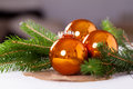 Shiny bright copper colored Christmas balls Royalty Free Stock Photo