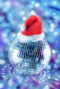 Shiny disco ball in santa hat Stock Image