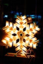 Shiny electric christmas snow flake symbol, on dark nocturnal background. Royalty Free Stock Photo