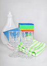 Shiny glasses liquid and sponges bottle with washing towels Royalty Free Stock Images