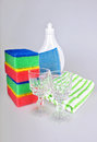 Shiny glasses liquid and sponges bottle with washing towels Stock Photography